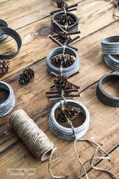 Rim and twig garland / Industrial Christmas decor from canning jar rims! Primitive Christmas, Rustic Christmas, Christmas Holidays, Industrial Christmas Decorations, Fall Decorations, Christmas 2017, Christmas Tree, Jar Lid Crafts, Mason Jar Crafts