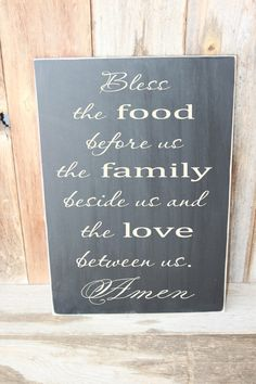 Kitchen  - Bless the food before us, the family beside us... wood subway art wall hanging with vinyl lettering. $19.99, via Etsy.