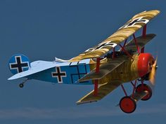 """World War I Fokker Dr.1 Triplane ~ there were a few German planes that had the """"swastica"""" as a symbol on their plane but at that time, 1916-1918, all it sybolized was good luck, no other conotations at that time."""