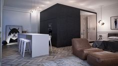 Interior MA by INT2 Architecture - chevron floor + modern black cube + white table + gothy leaning art