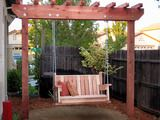 "DIY Yard swing with Trellis...I love this for the ""play"" side of the yard to have a nice place to sit and watch kids play.  Though, I'd do something a little more fancy for the seat."