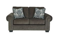 "The Navasota Loveseat from Ashley Furniture HomeStore (AFHS.com). The ""Navasota-Charcoal"" upholstery collection features a soft chenille upholstery fabric surrounding beautifully rolled arms adorned with nail head accents along with plush pillow back cushions to create the perfect Traditional Classic furniture to enhance any living room décor."