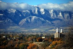 Logan Temple, fall colors, and mountains dusted with snow.