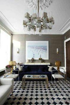 grasscloth wallpaper + navy sofa  -lighting-interior-design-indulge-daily-velvet-navy-graphic-rug