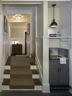 """This small, integrated """"slop"""" sink is part of the Mudroom that is found in so many Midwest The compact sink plays a key role in the battle against dirt in the house.Careful use of this tight space maximizes its usefulness."""