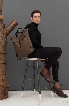 A practical rucksack in British waxed cotton with a soft leather base, ample front pocket with bridle leather fastening. Features an inner mesh pocket and two side pockets for extra storage space. Available in black and khaki. Extra Storage, Wool Coat, Soft Leather, British, Mesh, Pockets, Space, Natural, Cotton