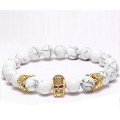 Golden Crown Skull Bracelet - Skullflow    https://www.skullflow.com/collections/skull-bracelets/products/golden-crown-skull-bracelet