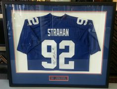 Custom framed Michael Strahan jersey with custom name plate. Custom framed by FastFrame of LoDo