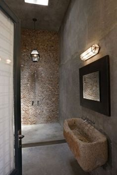 "In this bathroom, the sink is a repurposed trough from a local farmer. ""It even has a notch where the little lambs used to drink with the bigger sheep. Check the great open shower."