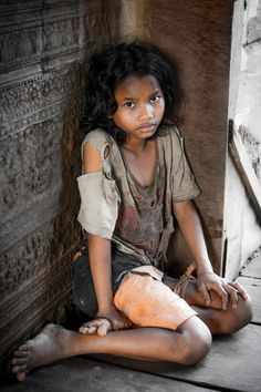 Poor Girl | Angkor Wat, Cambodia/ I want to run in, care for and protect her.... Sad world.