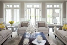 Love the chairs, couches, color and light. . . .but not the spikey things on the table. Parkwood Road | Marth O'Hara Interiors