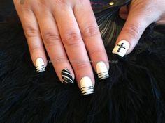 Full set of acrylic nails with white and black polish with free hand nail art ,black Swarovski crystals