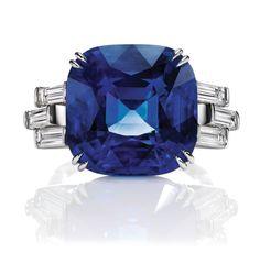 Sunset by Harry Winston, Sapphire and Diamond Ring/Cushion-cut sapphire, 18.51 carats; 6 baguette diamonds, 1.25 total carats; platinum setting.