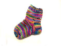 Free mini knitted sock pattern! This would be great for Christmas ornaments! Click through and download!