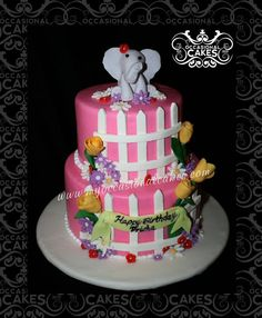 a sweet little elephant surrounded by flowers... cute, girly birthday cake
