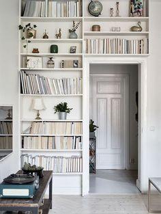 shelves over / around a doorway