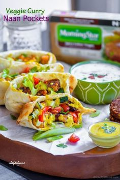 Grilled Indian Naan Pockets filled with grilled spicy Indian veggie patties, grilled zucchini, fresh cherry tomatoes and easy curry dressing