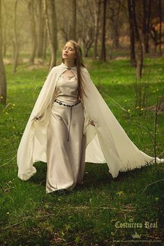 This gown is made in ivory satin for the body and the cloak, and ivory chiffon for the sleeves.  The gown included the cape and the belt.  The size