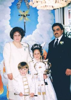 The Faria Family; Kayla in the center holding the Holy Ghost crown.