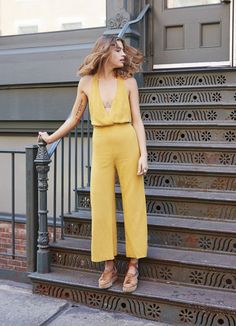 This pale yellow v neck jumpsuit is everything!