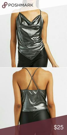 Metallic Assymetrical Top A shimmery metallic knit shapes this ultra - sexy sleeveless top ! Thin straps top the draped neckline , that flows into a pointed assymetrical hem below. Crisscross straps in back add a touch of luxe to every angle. Charlotte Russe Tops Tank Tops