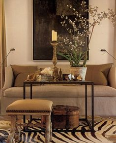 .good sofa. Love little standing lamps.