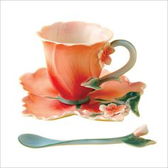 Two's Company Hibiscus Tea Set:  A delicately sculpted saucer and matching cup in a deep rose shade with a sprinkling of blossoms in handpainted porcelain.  What better way to celebrate tea time.  Three piece set includes teacup, saucer and spoon.  4