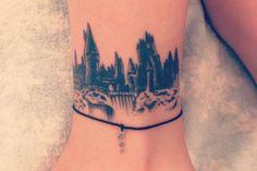 Hogwarts castle tattoo on left ankle.