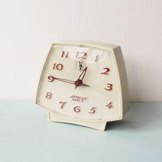 "vintage ""Apollo Mark II"" mechanical wind-up alarm clock."