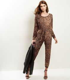 QED. Go wild this winter with this leopard print jumpsuit. Pair with simple black ankle strap heels for the perfect party look that is guaranteed to turn heads.- Rounded neckline- All over leopard print design- Tie waist- Simple long sleeves- Soft finish- Casual fit that is true to size- Jumpsuit length (as shown): 55.5