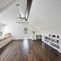 Attics love the sliding door and the contrast between the white wall and the dark wood
