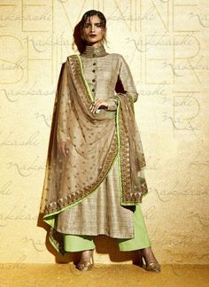 Featuring beige and pista green embroidered designer suit intricately crafted with resham, zari and sequins work.It is paired with matching bottom material and net duppata.This outfit can be stitched upto size 44. For stitching enquiries, please email us at customercare@hunardesigns.com   …