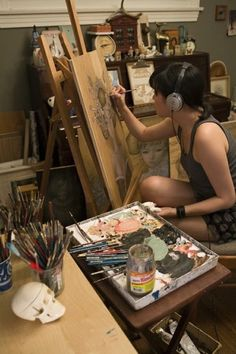 Audrey Kawasaki in her studio. I never thought of using a comfy chair in front of an easel.