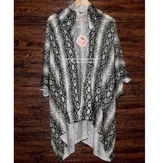 SHOW ME YOUR MUMU Cardigan Long Sweater Hood Wrap Size Small.  New with tags. $136 Retail + Tax.   Soft patterned cardigan featuring cozy knit folds - creating a cool layering effect.  3/4 length sleeves and hood at back.    MuMu Mellow.    ❗️ Please - no trades, PP, holds, or Modeling.    Bundle 2+ items for a 20% discount!    Stop by my closet for even more items from this brand!  ✔️ Items are priced to sell, however reasonable offers will be considered when submitted using the blue…