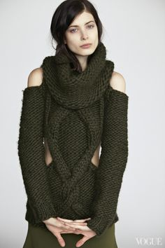 Hand-knit, with cutouts and a detachable cowl: Larissa Hofmann wearing a Prabal Gurung Loden Green handknit wool cutout sweater with detachable cowl, $2,395Barneys New York, NYC, 212.826.8900