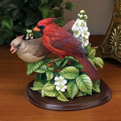 """""""Summer Cardinals"""" is everything that made Roger Tory Peterson a legendary artist.  The birds seem alive, ready to move before your eyes.  Wherever you look, from any angle, the detail is astonishing.     Preserving the wealth of subtle detail, """"Summer Cardinals"""" is meticulously crafted of cold-cast porcelain.  To achieve the lifelike realism, skilled artisans masterfully hand paint the sculpture in vibrant natural hues found in nature."""