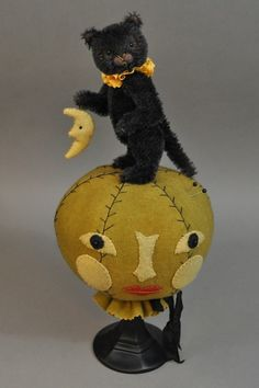 Wonderful Pin Cushion of Kitty with her moon. Made by the Talented Lori Ann Corelis. I love her work whether it be a teddy or a friend....they are all just delightful !! Photo via Lori's blog.