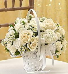 All White Flower Girl Arrangement- white roses, cream-colored roses, white lisianthus and stephanotis $25.00