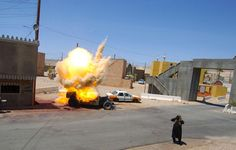 A simulated improvised explosive device (IED) explodes during a mass-trauma training exercise at Medina Wasl, a training village at the National Training Center on Fort Irwin.