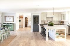 LOVE these floors - perfect color -- not too like or dark (hides dirt!) --As seen on HGTV's pilot episode of 'Rafterhouse'. ---- The wood flooring is by Provenza. It's their Heirloom series.