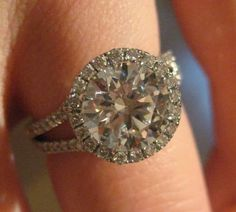 Top view of split shank pave round cut halo engagement ring (the center diamond sits flush with the halo and no gap) Nice size center diamond!