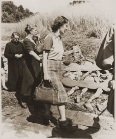 German women from Nammering are forced to walk among the corpses of prisoners exhumed from a mass grave.  Though the women are in obvious distress at the sight of the corpses, it is difficult to feel even the slightest pity for them.  Civilians who lived in areas surrounding extermination camps could not plausibly deny the existence of those camps or knowledge of the atrocities committed there.