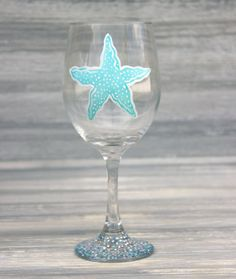 Starfish wine glass. Multiple colors and personalization available at Blue Dogwood Boutique.