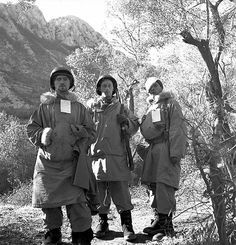 "Canadian personnel of the First Special Service Force awaiting medical evacuation, near Venafro, Italy, January 1944. Sergeant Roy Cooper, Portage LaPrairie, MB; Sergeant Fred Hill, Havelock, ON; and Sergeant Norman D. Torpe, Metiskou, AB. All three men served in the 1st Regiment, SSF. According to Ken Joyce, the photo was taken ""in the shadow of Mount Sammucro in the vicinity of Ceppagna."""