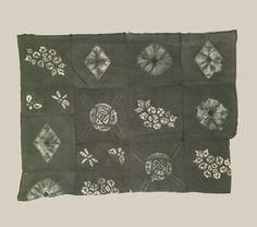 "Shibori Panel, Taisho (1912-1926). An unusual cotton cloth made up of 14 squares stitched together. Each square contains a single motif dyed with shibori.  40"" x 54"". Yorke Antique Textiles"