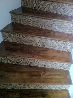 Wooden and Tile staircase.  Staircase update by Foster's Construction and Remodeling