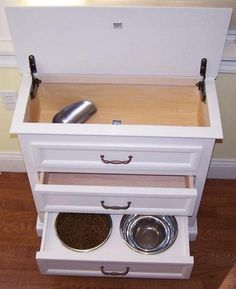 What a cute idea!!  Love it!!  Space saving solutions for your pet's food and water dishes. Hidden Storage Ideas We Love at Design Connection, Inc. | Kansas City Interior Designer