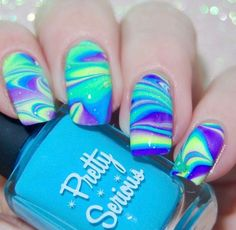 Water marble nail art in blue and purple using Pretty Serious polish
