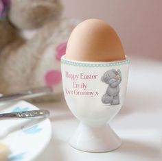 You can personalise this Easter Me To You Egg Cup with a message over 3 lines of 15 characters per line The design features the cute Tatty Teddy with