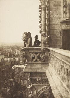 Henri Le Secq stands next to a gargoyle at Notre-Dame Cathedral, Paris, by…